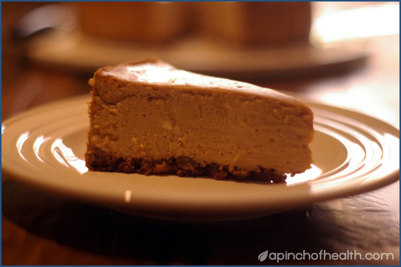 photo of a slice of pumpkin cheesecake
